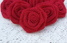 Red burlap roses, by DixieByDesign on etsy.com