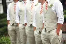 Taupe vests with coral ties