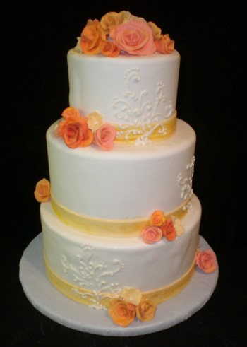 Wedding cake in coral and yellow