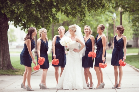 Bridesmaids in navy with coral bouquets {via fabyoubliss.com}
