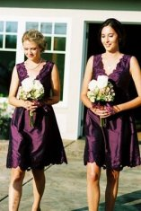 Bridesmaids in purple dresses {via theeverydaybride.blogspot.com