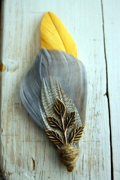 Feather boutonniere, by PompAndPlumage on etsy.com