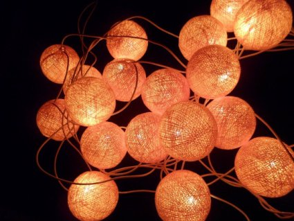 Orange cotton ball string lights, by girlbabyhairbows on etsy.com