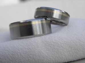 Titanium and yellow-gold rings, by titaniumknights on etsy.com
