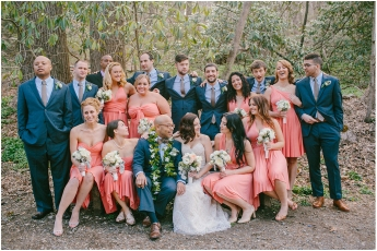 Wedding party in coral and navy colours {via www.maineweddingcompany.com}