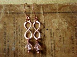 Infinity earrings, by PendragonJewelry on etsy.com