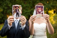 Bride and groom with childhood photos