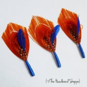 Feather boutonnieres, by TheHeadbandShoppe on etsy.com