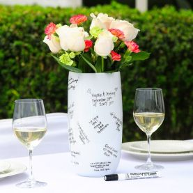 Guests sign a vase as a guestbook