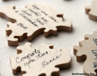 Guests sign puzzle pieces for you to keep