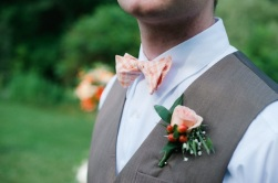Groom with a peach bowtie and boutonniere {via lover.ly}