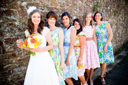 Bridesmaids in floral dresses {via youmeantheworldtome.co.uk}