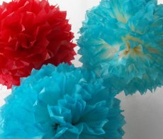 Paper pompoms, by HandDyedPoms on etsy.com