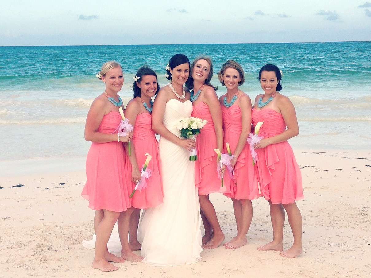 Bridesmaids in coral dresses with aqua necklaces via for Coral bridesmaid dresses for beach wedding