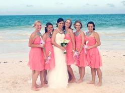 Bridesmaids in coral dresses with aqua necklaces {via thatsmineboutique.blogspot.com}