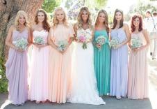 Bridesmaids in different pastel dresses {via greenweddingshoes.com}
