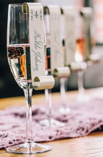 Champagne escort card idea {via 100layercake.com}