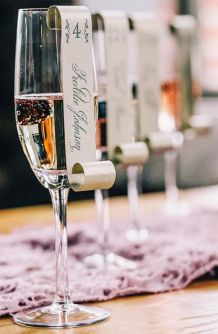 Champagne escort card idea {via 100layercake.com}
