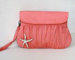 Coral clutch purse with starfish brooch, by Oyeta on etsy.com