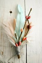 Feather boutonniere for the groom {via alowcountrywed.com}