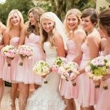 Bridesmaids in light pink dresses with pink and green bouquets {via theknot.com}
