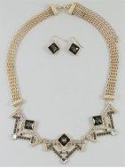 Gold bib necklace with matching earrings, by PeaceandAdorn on etsy.com