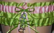 Wedding garter in apple green and light pink, by WeddingGarterStore on etsy.com