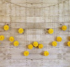 Yellow tissue-paper pom garland, by giddy4paisley on etsy.com