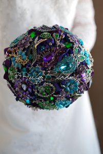 Brooch bouquet in peacock colours, by Rubybloomscom on etsy.com