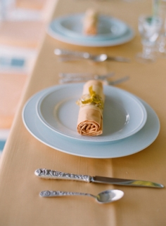 Peach, light blue and yellow table setting {via oncewed.com}