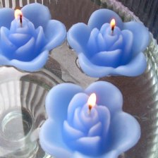 Periwinkle floating rose candles, by GlowliteCandles on etsy.com