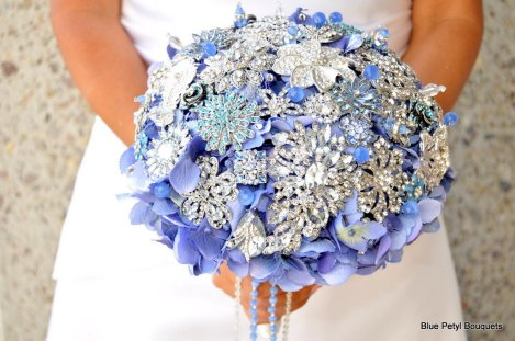 Periwinkle hydrangea brooch bouquet {via lover.ly)