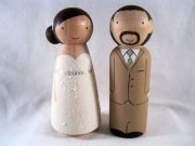Personalised peg doll cake toppers, by knottingwood on etsy.com