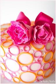 Pink and orange 'bubble' wedding cake {via aweddingcakeblog.com}