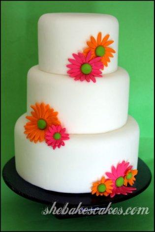 Pink and orange wedding cake {via shebakescakes.com}