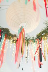 Add streamers to paper lanterns {via weddingstar.com}