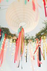 Add streamers to paper lanterns {via weddingstar.com}