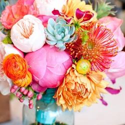 Aqua, pink and orange bouquet {via weddingbee.com}