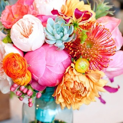 Aqua, pink and orange bouquet {via weddingbee.com}