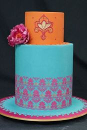 Aqua, pink and orange wedding cake {via cakewrecks.com}