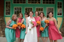 Bridesmaids in aqua and pink with orange bouquets {via lover.ly}