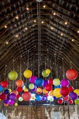 Colourful paper lanterns {via weddingwire.com}