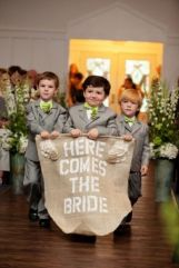 Cute little pageboys carrying a sign {via lover.ly}