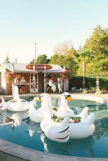 Decorative blow-up swans {via 100layercake.com}