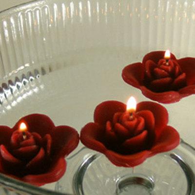 Oxblood floating rose candles - www.etsy.com/shop/GlowliteCandles