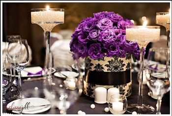 Black, white and purple table setting {via weddingsbythecolor.com}