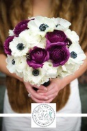 Black, white and purple wedding bouquet {via bouquetweddingflower.com}