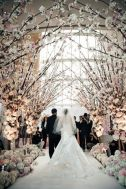 Beautiful flower-lined aisle {via colincowieweddings.com}