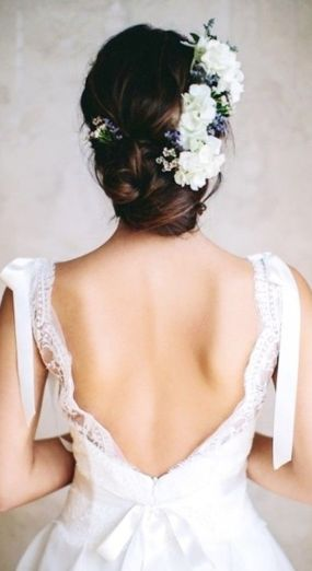Hairstyle with flowers {via stylecaster.com}