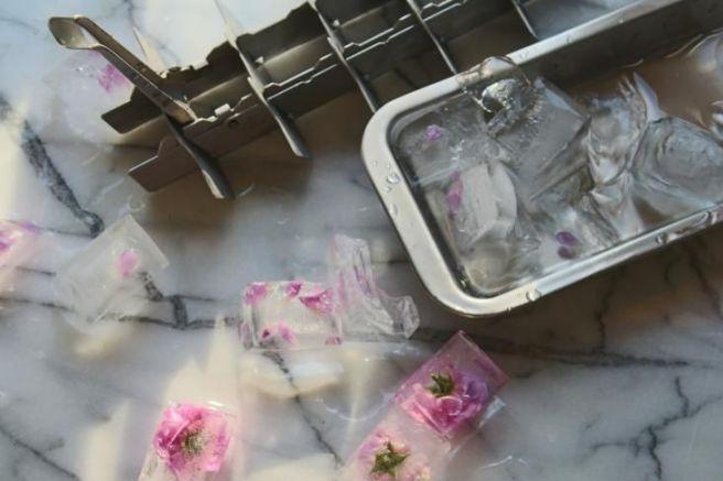 Rose petals in icecubes tutorial - http://www.gardenista.com/posts/diy-rose-petal-ice-cubes